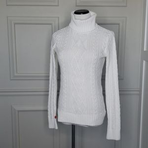 White cableknit turtleneck sweater